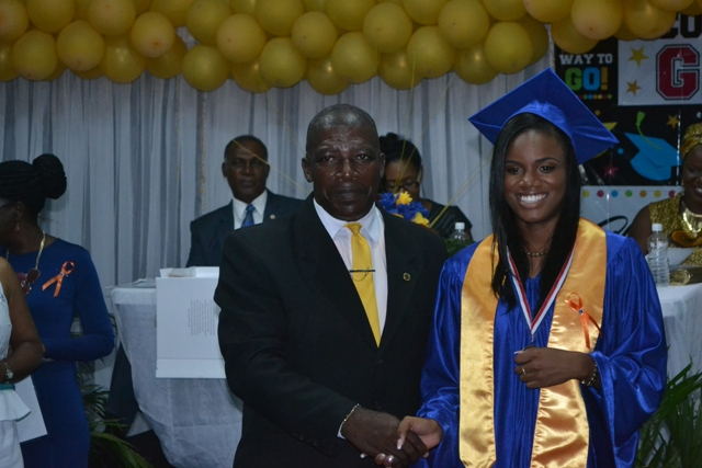 Valedictorian of the Charlestown Secondary School's (CSEC) graduating class of 2015 Nekhaila Tyson with Principal Edson Elliot moments after she is presented with the Principal's Medallion at the Charlestown Secondary School and the Nevis Sixth Form College at their Graduation and Prize-giving Ceremony at the Cicely Grell-Hull Dora Stevens Netball Complex on November 11, 2015