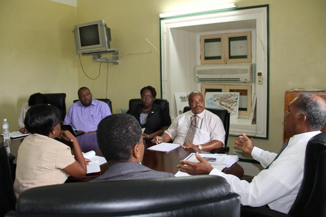 A meeting in session with Premier of Nevis Hon. Vance Amory (head of the table), other Nevis Island Administration officials and executive members of the Nevis Teachers' Union and the St. Kitts Teachers' Union at the Nevis Island Administration's conference room at Bath Hotel on November 11, 2015