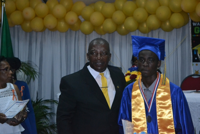 Valedictorian of the Charlestown Secondary School's graduating class of 2015 (CCSLC)  Chris-Andrew Smith with Principal Edson Elliot moments after he is presented with the Principal's Medallion at the Charlestown Secondary School and the Nevis Sixth Form College at their Graduation and Prize-giving Ceremony at the Cicely Grell-Hull Dora Stevens Netball Complex on November 11, 2015