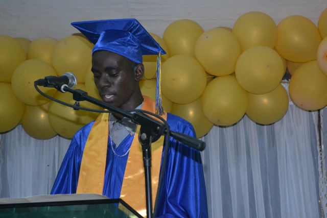 Chris-Andrew Smith, Valedictorian of the Charlestown Secondary School's CCSLC Class of 2015, delivers his valedictory speech at the Graduation and Prize-giving Ceremony for the Charlestown Secondary School and the Nevis Sixth Form College at the Cicely Grell-Hull Dora Stevens Netball Complex on November 11, 2015