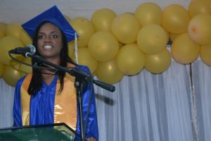 Valedictorian of the Charlestown Secondary School's (CSEC) graduating class of 2015 Nekhaila Tyson delivering here valedictory speech at the Graduation and Prize-giving Ceremony for the Class of 2015 at the Cicely Grell-Hull Dora Stevens Netball Complex on November 11, 2015