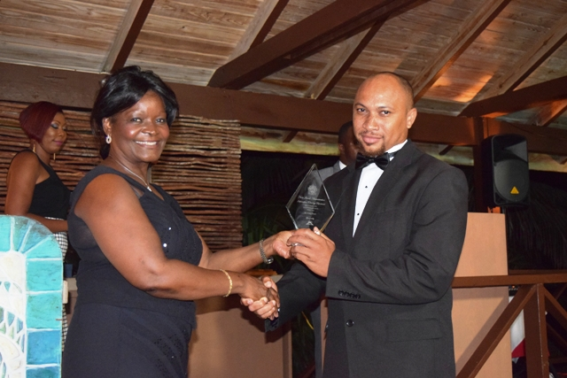 The Field Technician of the Year Award being presented to Geran Browne by Premier of Nevis Hon. Vance Amory's wife Mrs. Verni Amory, at the first IT Delta Awards on December 19, 2015, at the Nisbet Plantation Inn