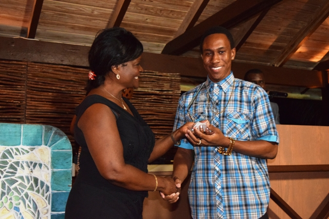 Ticketeer Award being presented to Shakir Stapleton by Premier of Nevis Hon. Vance Amory's wife Mrs. Verni Amory, at the first IT Delta Awards on December 19, 2015, at the Nisbet Plantation Inn