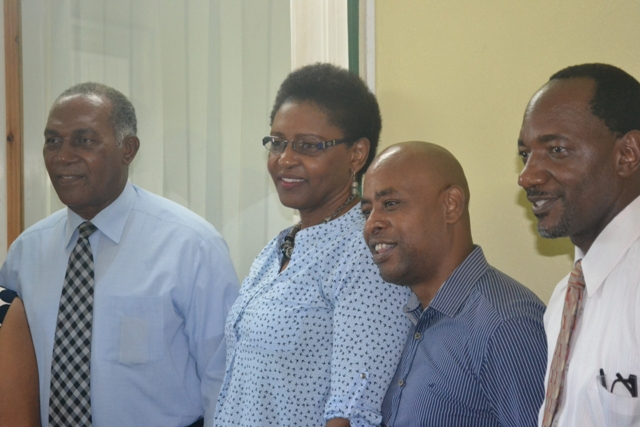 (l-r) Premier of Nevis and Minister of Education Hon. Vance Amory with European Union Consultant responsible for TVET and Training Karen Gayle, European Union Consultant responsible for TVET and Quality Assurance Orlando Hewitt and Assistant Permanent Secretary in Premier's Ministry Mr. Kevin Barett following a meeting at the Nevis Island Administration's conference at Bath Plain on November 27, 2015