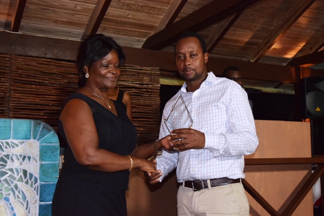 The Innovator Award being presented to Theon Drew by Premier of Nevis Hon. Vance Amory's wife Mrs. Verni Amory, at the first IT Delta Awards on December 19, 2015, at the Nisbet Plantation Inn
