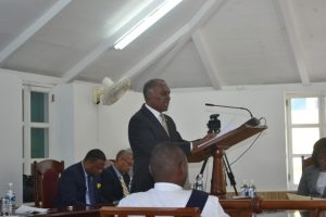 Premier of Nevis and Minister of Finance Hon. Vance Amory delivering the 2016 Budget Address at a sitting of the Nevis Island Assembly on December 08, 2015. In the background are (l-r) Deputy Premier of Nevis Hon. Mark Brantley and Legal Advisor to the Nevis Island Administration Collin Tyrell