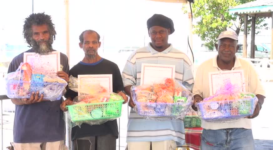 Sanitation Workers honoured by the Nevis Air and Sea Ports Authority for their contribution to the upkeep of Charlestown (l-r) Donald Browne, Raoul Archibald, Franklyn Browne and George Herbert showing off their certificates of appreciation and gift baskets on December 14, 2015