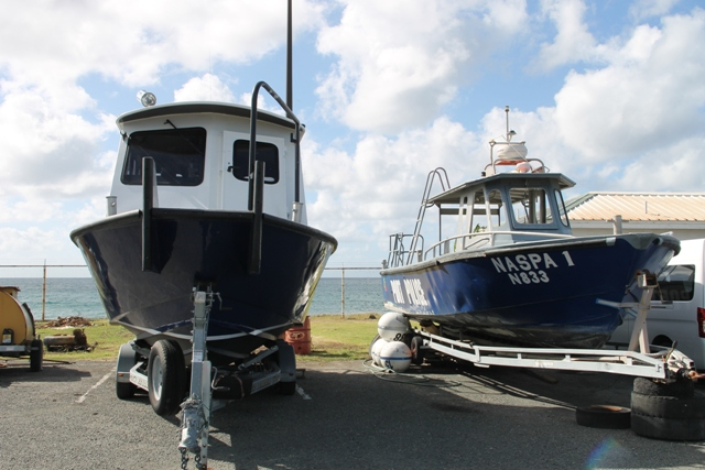The older patrol vessel (right), sitting next to the new vessel at the Long Point Port, is available for sale by the Nevis Air and Sea Ports Authority