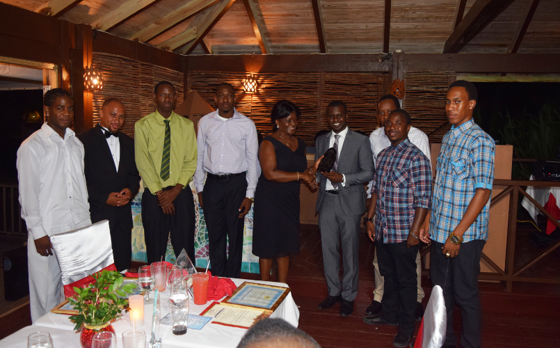 The Team Award from the Ministry of Finance and the Human Resources Department being presented to Director of the Information Technology Department Quincy Prentice and his staff by Premier of Nevis Hon. Vance Amory's wife Mrs. Verni Amory, at the first IT Delta Awards on December 19, 2015, at the Nisbet Plantation Inn in recognition of their outstanding performance and dedicated service to the Nevis island Administration