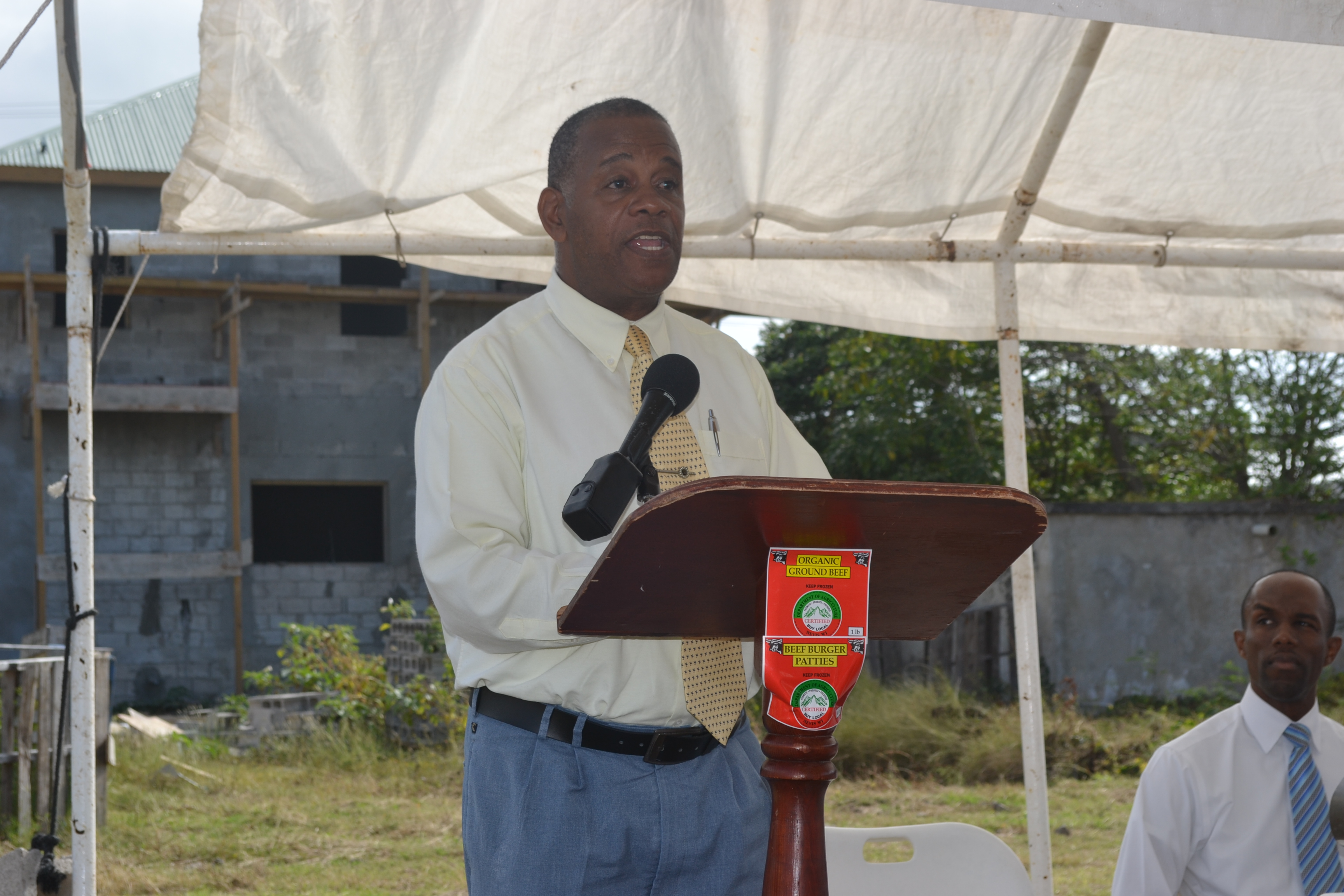 Permanent Secretary in Ministry of Agriculture Mr. Eric Evelyn delivering Welcome and Opening remarks at the Ground Breaking Ceremony for the extension of the Abattoir Division on the Abattoir Division Grounds on January 26 2016