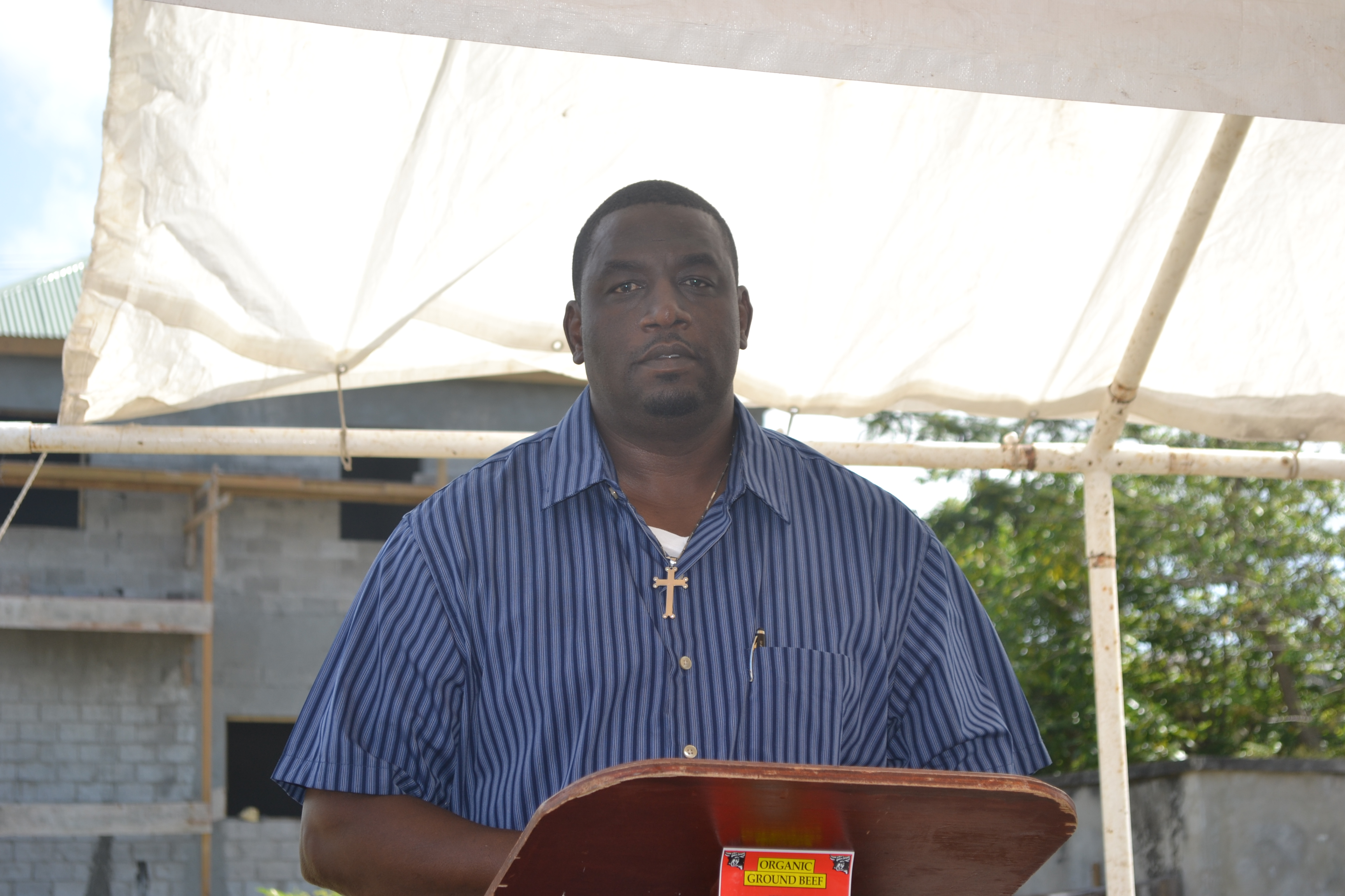 Manager of the Abattoir Mr. Garfield Griffin making remarks at the Ground Breaking Ceremony for the extension of the Abattoir Division on the Abattoir Division Grounds on January 26 2016