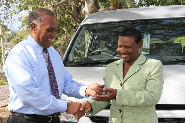 Premier of Nevis and Minister of Education Hon. Vance Amory hands the keys to a brand new Toyota Hiace bus for parents and students of the Cecele Browne Integrated School at Prospect at a handing over ceremony at the grounds of the Nevis Island Administration Building at Bath Hotel on January 05, 2015
