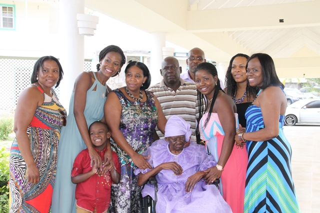 "Nevis' eldest centenarian Celian ""Martin"" Powell with her family at her 104th birthday celebration at the Flamboyant Nursing Home on January 19, 2016"