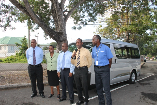 (L-R) Premier of Nevis and Minister of Education Hon. Vance Amory, Principal Education Officer Palsy Wilkin, Permanent Secretary in the Ministry of Education Wakely Daniel, Assistant Secretary in the Premier's Ministry Kevin Barrett and TDC Representative Tony Nisbett at the handing over ceremony of a new Toyota Hiace bus for parents and students of the Cecele Browne Integrated School at the grounds of the Nevis Island Administration Building at Bath Hotel on January 05, 2015