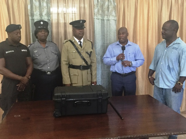 (L-R) Director of St. Kitts Marine Works Ltd. Regiwell Francis looks on as Minister in the Nevis Island Administration Hon. Alexis Jeffers hands over a thermal imaging camera to Divisional Fire Officer David Stapleton in the St. Kitts and Nevis Fire and Rescue Services, Nevis Division at their Headquarters in Charlestown on January 19, 2016