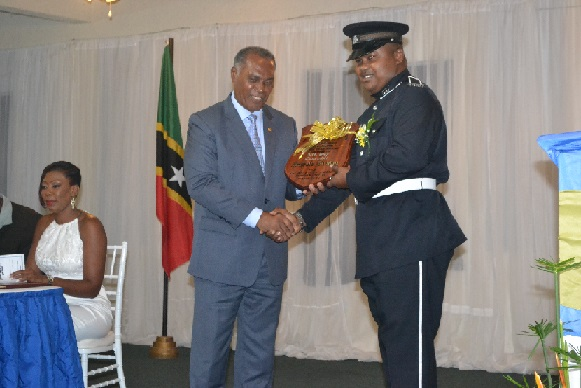 Constable Antonio Brown receiving plaque for most outstanding Constable of the Year 2015 during Constables' Awards Ceremony held on February 06 2016 at Occasions Entertainment Arcade