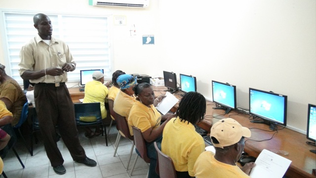 Sean Joseph, Facilitator of the Computer Skills Course for Seniors instructing trainees at the VOJN Primary School Computer Laboratory on February 01 2016