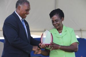 Premier of Nevis Hon. Vance Amory presents a plaque to the Department of Agriculture's 22nd Annual Open Day Patron Dulcina Brookes-Byron at the opening ceremony at the Villa Grounds on March 17, 2016
