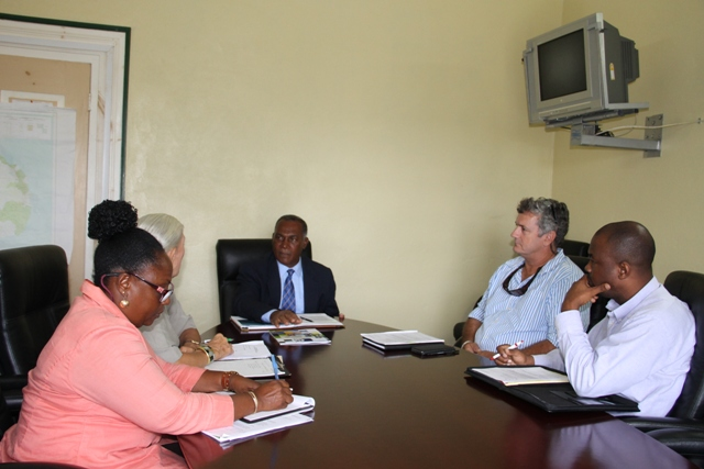 Premier of Nevis Hon. Vance Amory (at the head of the table) with (l-r) Vice President of the Nevis Chapter of the St. Kitts and Nevis Chamber of Industry and Commerce Patricia Claxton, Administrator Deborah Lellouch, Past Chairman Mark Theron and Treasurer Warren Moving at a meeting at the Nevis Island Administration's conference room at Bath Hotel on March 08, 2016