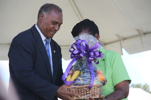 Premier of Nevis Hon. Vance Amory presents a fruit basket to the Department of Agriculture's 22nd Annual Open Day Patron Dulcina Brookes-Byron at the opening ceremony at the Villa Grounds on March 17, 2016