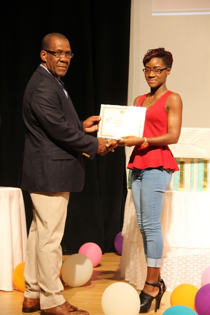 Genesia Pemberton is awarded a special prize for her participation in the Ministry of Tourism's Annual Photographer of the Year Competition 2016 at the Awards Ceremony at the Nevis Performing Arts Centre on March 18, 2016