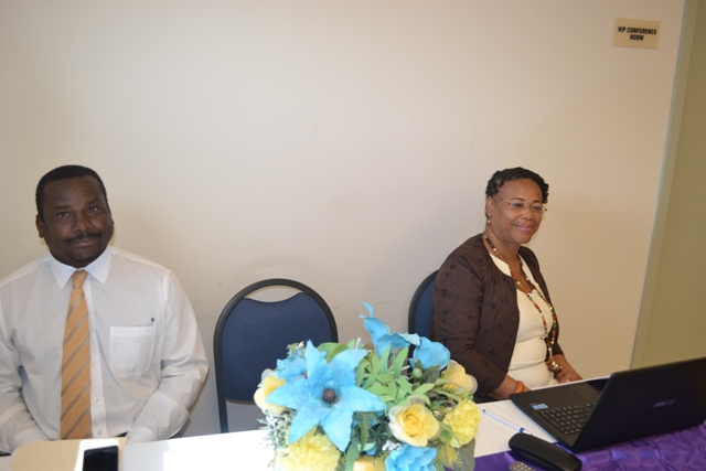 (l-r) Keith Glasgow, Permanent Secretary in the Ministry of Social Development on Nevis and Poetry Writing Workshop facilitator Cynthia Grenyion at the opening ceremony on March 22, 2016 at the Nevis Disaster Management Office Conference Room at Long Point