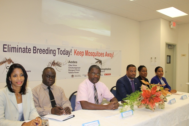 Seating at the head table at the launch of the Ministry of Health's Health Promotions Unit Zika Virus/Mosquito Prevention and Control campaign at a press conference at the Nevis Disaster Management Office (NDMO) at Long Point on March 23, 2016. (L-r) Nadine Carty-Caines of the Health Promotions Unit, General Manager of the Nevis Solid Waste Management Authority Mr. Andrew Hendrickson, Chief Medical Officer in St. Kitts and Nevis Dr. Patrick Martin, Deputy Premier of Nevis and Minister of Health Hon. Mark Brantley, Medical Officer of Health on Nevis Dr. Judy Nisbett and Permanent Secretary in the Ministry of Health on Nevis Nicole Slack-Liburd
