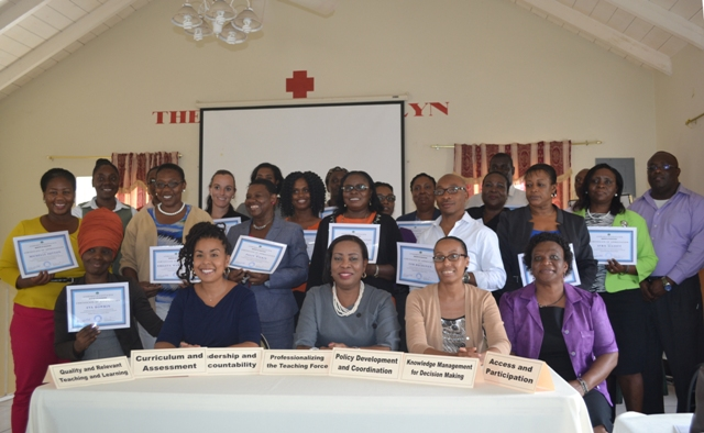 Participants in the St. Kitts and Nevis Ministry of Education's consultation on strategies for the Education Sector Plan showing off their Certificates of Appreciation at the Red Cross Conference Room, Nevis, on March 23, 2016. Seated at the table (second from left-right) National Coordinator for the Education Sector Plan Development Dr. Neva Pemberton, Permanent Secretary in St. Kitts and Nevis Ministry of Education Mrs. Ionie Liburd-Willet, Chief Education Officer in the St. Kitts and Nevis Ministry of Education Dr. Tricia Esdaille. and Senior Assistant Secretary in St. Kitts and Nevis Ministry of Education Mrs. Eleanor Phillip