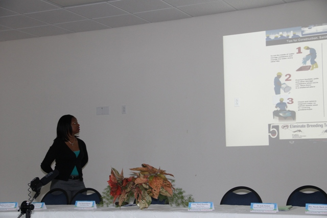 Health Educator Shevanée Nisbett making a presentation on the communication material and public service announcements in the Ministry of Health's Health Promotions Unit Zika Virus/Mosquito Prevention and Control campaign at a press conference to launch the campaign at the Nevis Disaster Management Office (NDMO) at Long Point on March 23, 2016