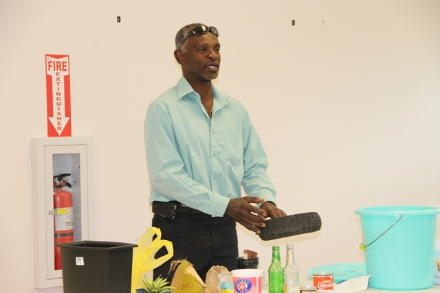 Port Health Officer Anthony Webbe in the Environmental Health Department demonstrating various vector control measures at the launch of the Ministry of Health's Health Promotions Unit Zika Virus/Mosquito Prevention and Control campaign at a press conference at the Nevis Disaster Management Office (NDMO) at Long Point on March 23, 2016