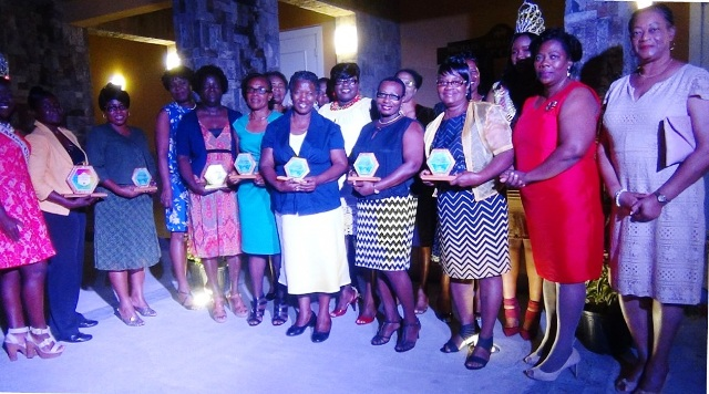 Awardees at the International Women's Day 2016 Women of Excellence Awards Ceremony and Cocktail on at the Nevis Performing Arts Centre in Pinney's on March 12, 2016. They are accompanied by Junior Minister responsible for Social Development Hon. Hazel Brandy-Williams, Resident Judge Justice Lorraine Williams, Magistrate Yasmin Clark and Londa Brown, Coordinator of School Libraries in the Department of Education