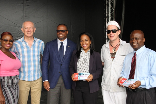 (L-R) Chairman of the local committee for the Nevis Blues Festival Shari Greaves, producer of the festival Richard Pavitt, Deputy Premier of Nevis and Minister of Tourism and Health Hon. Mark Brantley, Permanent Secretary in the Ministry of Health Nicole Slack-Liburd, renown Blues singer Ian Seigal, and Permanent Secretary in the Premier's Ministry with responsibility for Education Wakely Daniel at Oualie Bay on April 12, 2016, after a handing over ceremony of Nevis Blues Festival organisers' gift of tickets to nurses and teachers to attend the opening night of the 2nd edition of Nevis Blues Festival