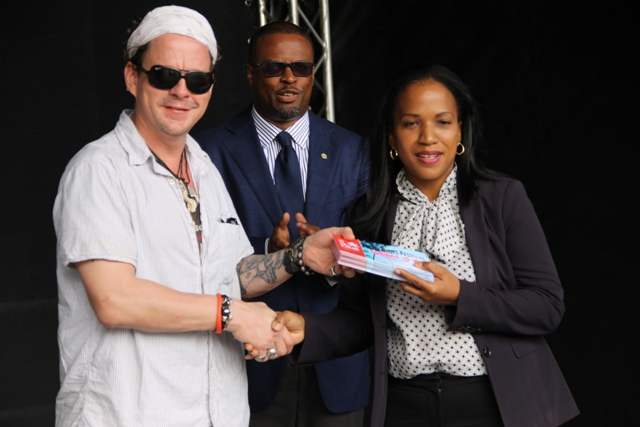 Permanent Secretary in the Ministry of Health Nicole Slack-Liburd receives tickets, to attend the opening night of Nevis Blues Festival, for nurses from renowned Blues singer Ian Seigal on behalf of organisers of the festival during a presentation ceremony at Oualie Bay on April 12, 2016