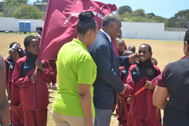 Premier of Nevis and Minister of Education Hon Vance Amory inspecting athletes with Marketing Manager of Gulf Insurance Ms. Lisa Hutson during the opening ceremony of the 24th Gulf Insurance Inter-Primary Schools Championship on March 30, 2016 at the Elquemedo T. Willet Park
