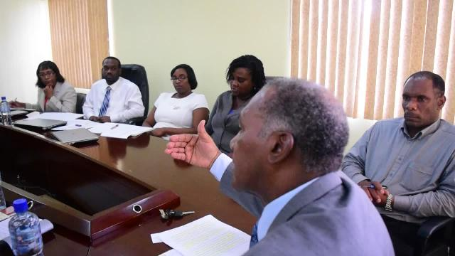 Premier of Nevis and Minister of Finance Hon. Vance Amory (extreme right), Permanent Secretary in the Ministry of Finance Colin Dore (second from right) and his staff at a meeting with a visiting team from the International Monetary Fund on April 25, 2016, at the Ministry of Finance conference room