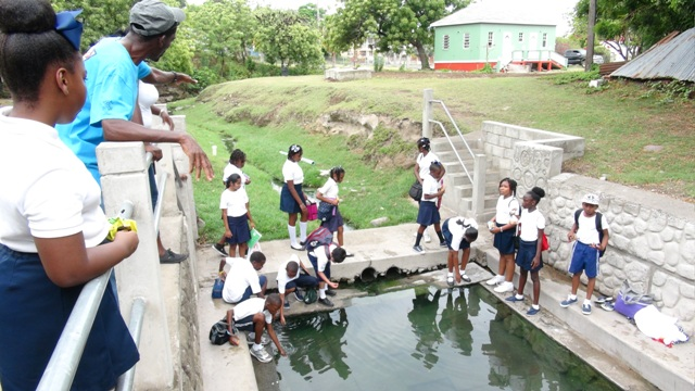 Students of Nevis Academy touring the Bath hot springs on April 18, 2016, as part of the Ministry of Tourism's Exposition Nevis, tourism awareness activities. They are led by tour guide Lemuel Pemberton