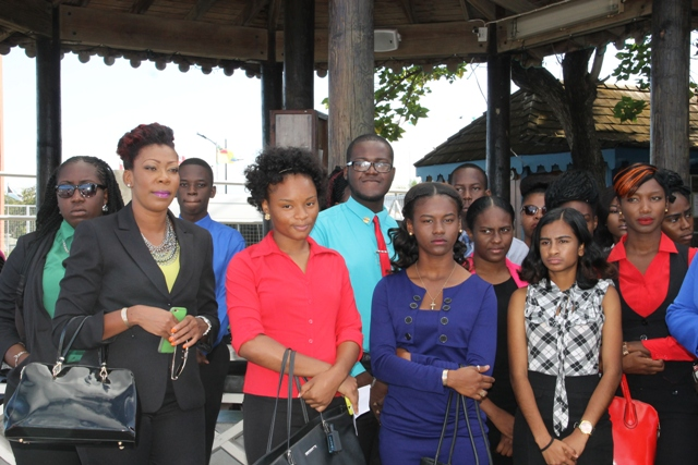 Ms. Camara Lee, Chair of the Nevis Island Youth Council's Steering Committee leading a group of Nevis youths at the Charlestown Pier on April 04, 2016, moments before their departure for St. Kitts to attend a forum as part of Diplomatic Week 2016