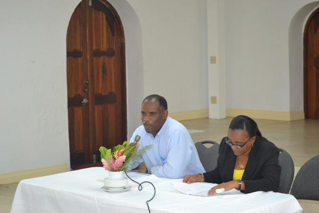 (L-r) Permanent Secretary in the Ministry of Finance Colin Dore and Director of Small Enterprise Development Unit Catherine Forbes at the opening ceremony of the Caribbean Development Bank funded Managing for Development Results workshop at the St. Paul's Anglican Church Hall on April 12, 2016