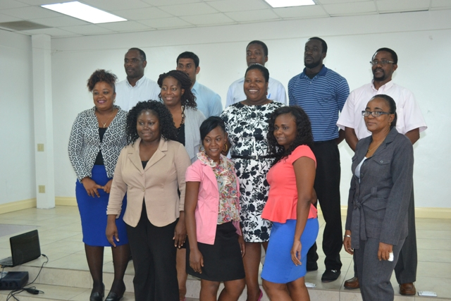 Participants of the Caribbean Development Bank funded training workshop hosted by Small Enterprise Development Unit at the St. Paul's Anglican Church Hall on April 14, 2016, with Permanent Secretary in the Ministry of Finance Colin Dore (top row extreme left) and Facilitators Nicole Liburd (second row second from left) and Catherine Forbes (front row extreme right)