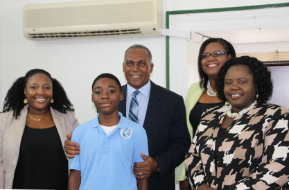 Letisha Dore and her son Jayden Dore, Premier of Nevis Hon. Vance Amory, Coordinator of Youth Development Zahnela Claxton and Junior Minister of Youth and Sports Hon. Hazel Brandy-Williams at Mr. Amory's office at Bath Hotel on April 19, 2016