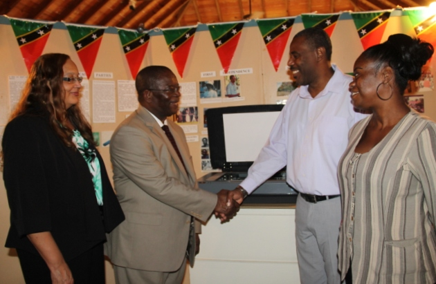 St. Kitts and Nevis Ambassador to the Organisation of American States His Excellency Dr. Everson Hull (middle left), handing over an Epson Expression 11000XL photographic scanner to Devon Liburd on behalf of the Nevis Historical and Conservation Society on April 12, 2016, at the Museum of Nevis History for use in archiving historical data. Looking on are his wife Dr. Sandra Cooke-Hull (extreme left) and Archivist at the Museum of Nevis History Gail Dore (extreme right)