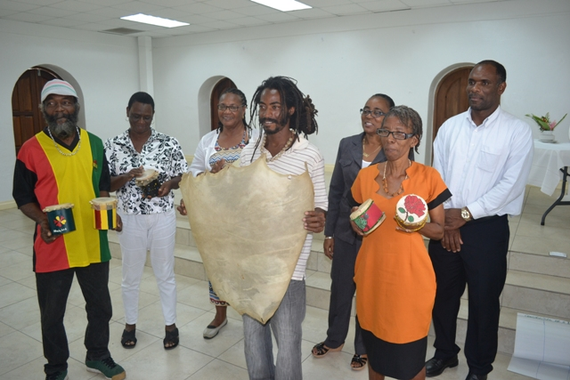 "(Back row l-r) Earl Rawlins, Debra Griffin (front row l-r) Clyde Arthurton and Yvonne ""Iona"" Rogers participants of the Leather Tanning Workshop hosted by the Small Enterprise Development Unit (SEDU) in the Ministry of Finance in March, showcasing their work during a certification ceremony at the St. Paul's Anglican Church Hall on April 14, 2016, with workshop facilitator Christobel Jeffers (back row third from left) Permanent Secretary in the Ministry of Finance Colin Dore (back row right) and head of SEDU Catherine Forbes (back row second from right)"