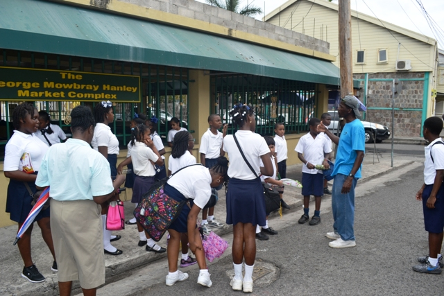Students of the Nevis Academy on a tour at the George Mowbray Market Complex on April 18, 2016, led by Lemuel Pemberton and organised by the Ministry of Tourism as part of its Exposition Nevis