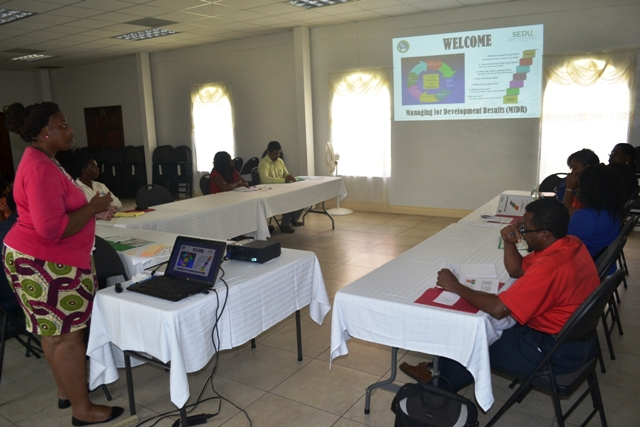 Nicole Liburd a facilitator at the Caribbean Development Bank funded Managing for Development Results workshop with participants at the St. Paul's Anglican Church Hall on April 12, 2016