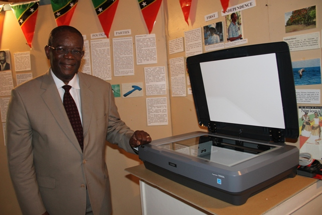 St. Kitts and Nevis Ambassador to the Organisation of American States His Excellency Dr. Everson Hull with the state-of-the-art Epson Expression 11000XL photographic scanner he donated to the Nevis Historical and Conservation Society on April 12, 2016