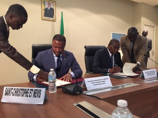 (l-r) Minister of Foreign Affairs in St. Kitts and Nevis Hon. Mark Brantley and Senegal's Foreign Minister Mankeur Ndiaye signing a joint communiqué, formalising ties between the two countries