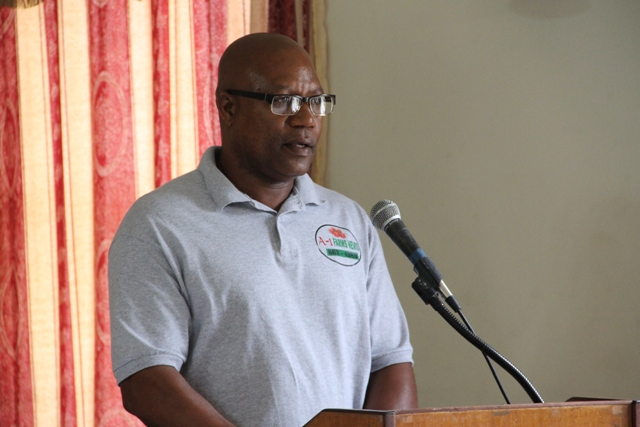 Mc Levon Tross, owner of A-1 Farms in Gingerland delivering remarks on behalf of recipients of the Department of Agriculture's Farmers Identification Card at a ceremony to launch the new initiative at the Red Cross conference room on May 24, 2016