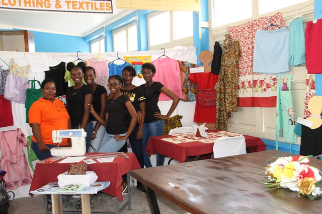 Clothing and Textiles tutor at the Charlestown Secondary School Multi-Purpose Centre Ms. Mavis Parris and her students showing off their work at the school's auditorium at their Technology and Art Exhibition on May 26, 2016