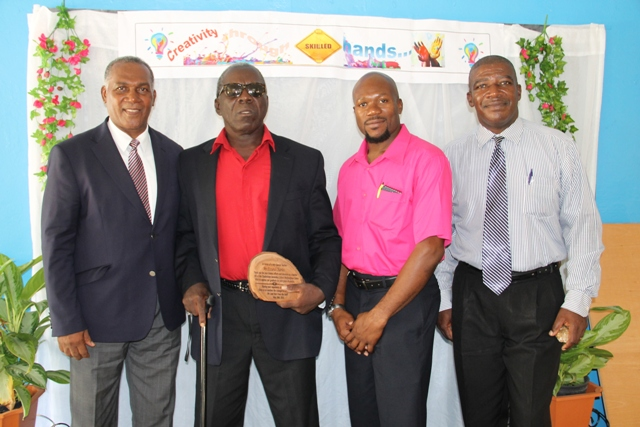 (L-R) Premier of Nevis and Minister of Education Hon. Vance Amory, former teacher at the Charlestown Secondary School Multi-Purpose Centre and patron of the Centre's Technology and Art Exhibition Mr. Ezzard Charles, Supervisor of the Centre Mr. Grafield Virgo and Principal of the Charlestown Secondary School Edson Elliott at the exhibition at the school's auditorium on May 26, 2016