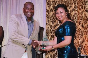 Derrick Huggins receives Ministry of Tourism's 2016 Hotel of the Year Award for the Nevis Plantation Beach Club from Mrs. Sharon Brantley, wife of the Minister of Tourism Hon. Mark Brantley on behalf of the Ministry of Tourism at the Tourism Awards Gala and Dance at the Four Seasons Resort on May 28, 2016